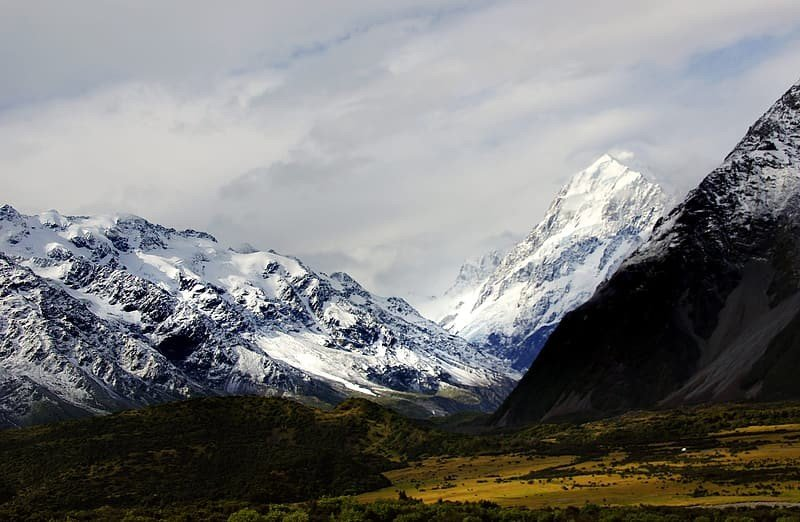 Witness the snow-dusted peaks of Mount Cook